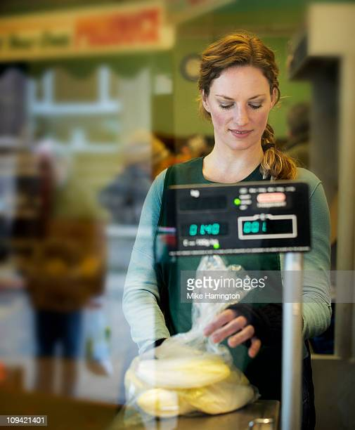 Female Grocer Weighing Fruit