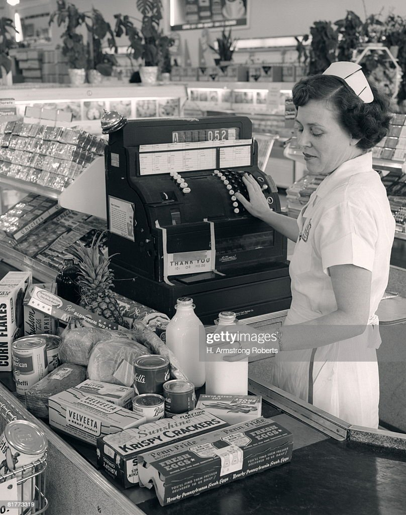 Female Grocery Cashier Ringing Purchases. : Stock Photo
