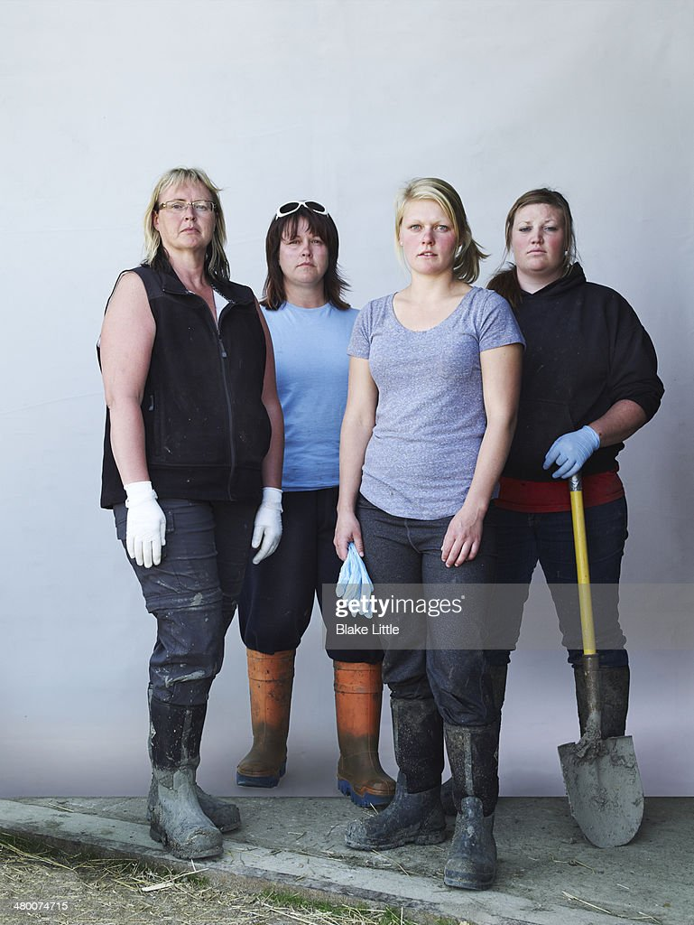 Female Group Feed Lot Workers : Stock Photo