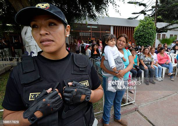 Female guards of the Peruvian National Penitentiary Institute keep an eye on the inmates celebrating Mothers Day two days in advance of the...