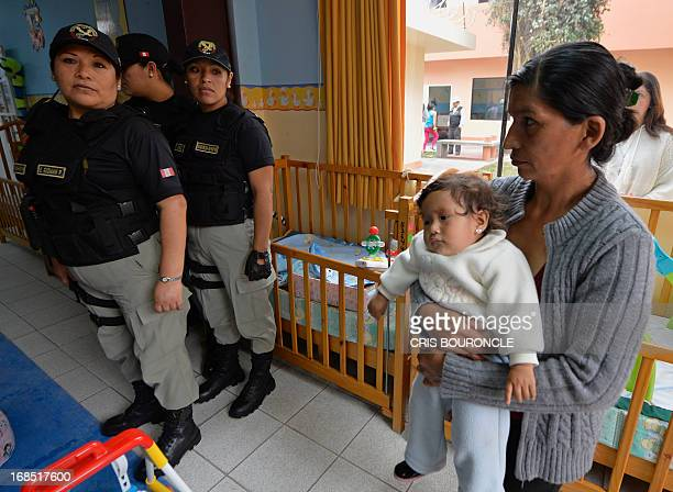 Female guards of the Peruvian National Penitentiary Institute patrol the facilities while inmates celebrate Mothers Day two days in advance of the...