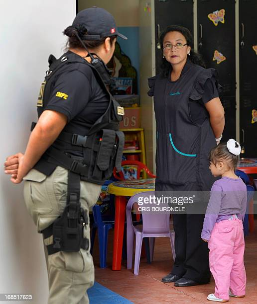 Female guards of the Peruvian National Penitentiary Institute patrol the facilities while the inmates celebrating Mothers Day two days in advance of...