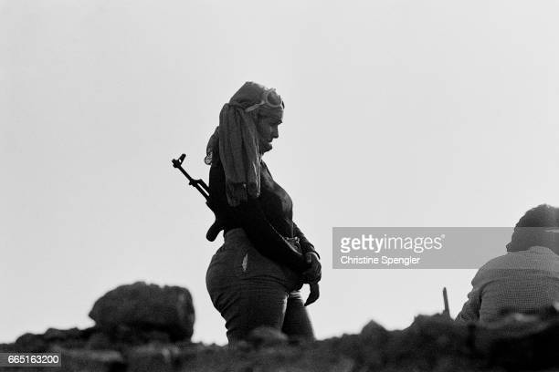 A female guerrilla fighter of the Polisario Front paces with her rifle in Western Sahara Polisario was formed in 1973 as a reaction towards several...