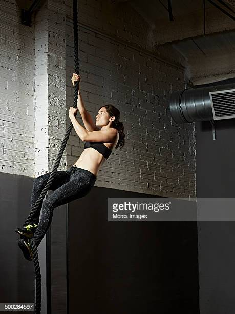 Female gym climbing rope