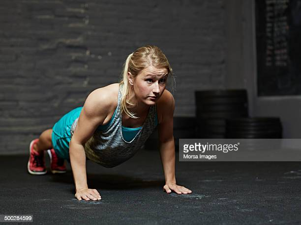 Female gym practicing pushups