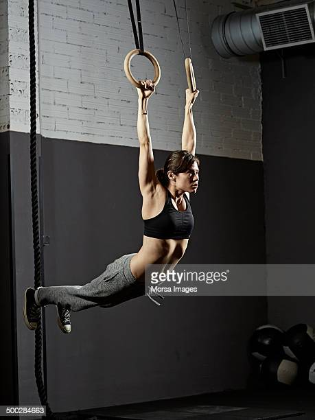 female gym training with gymnastics rings - frauen ringen stock-fotos und bilder
