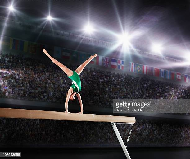 female gymnast competing on balance beam - gymnastics stock pictures, royalty-free photos & images