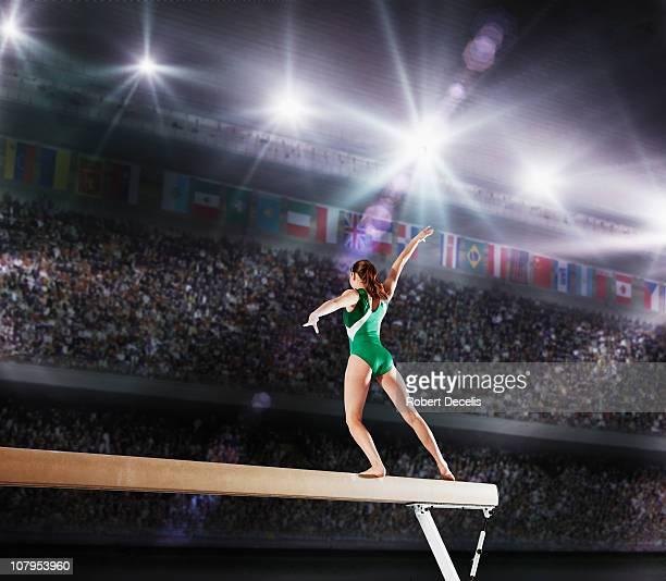 Female gymnast competing on balance beam