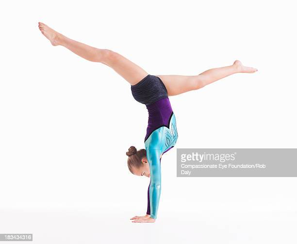 female gymnast doing handstand - gymnastics stock pictures, royalty-free photos & images