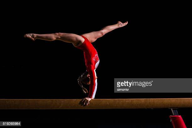 female gymnast in sports hall - gymnastics stock pictures, royalty-free photos & images