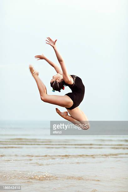 Weibliche Turner Jumping