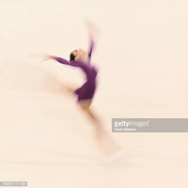 female gymnast leaping in competition routine - madison grace stock pictures, royalty-free photos & images