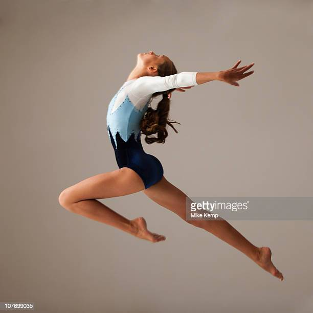 Female gymnast (12-13) leaping