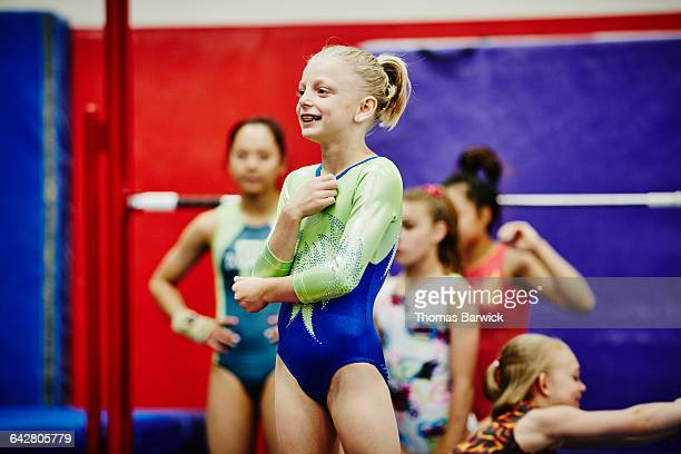Female gymnast listening to coaches instructions
