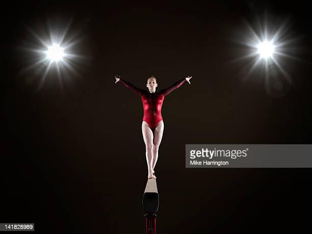 female gymnast on balance beam - balance beam stock pictures, royalty-free photos & images