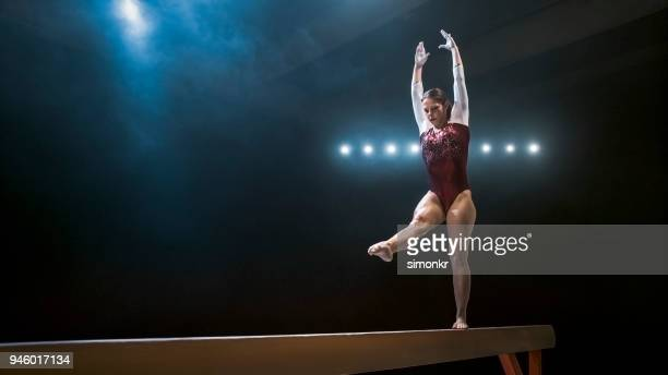 female gymnast on balance beam - gymnastics stock pictures, royalty-free photos & images