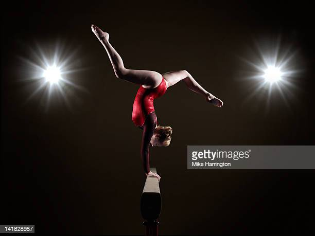 Female Gymnast on Balancing Beam.