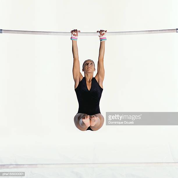 female gymnast on uneven bars. - horizontal bars stock pictures, royalty-free photos & images