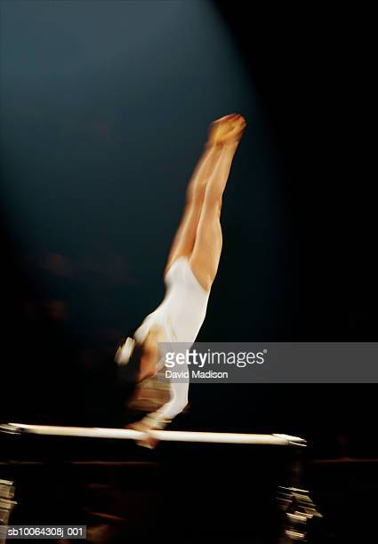 female gymnast on uneven bars - horizontal bars stock pictures, royalty-free photos & images