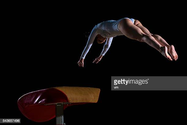 Female gymnast on vaulting horse