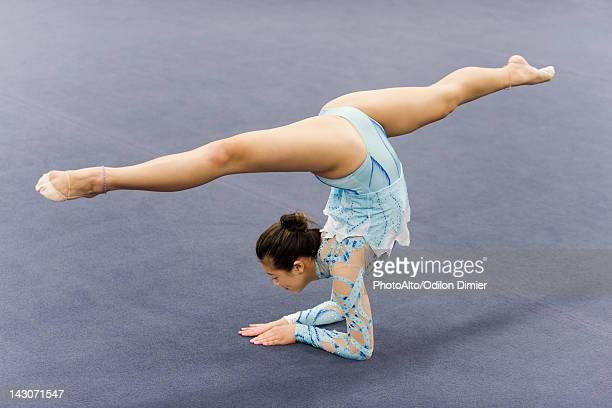 female gymnast performing elbow stand - rhythmic gymnastics stock-fotos und bilder