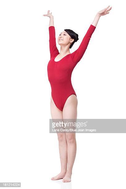 Female gymnast performing rhythmic gymnastics