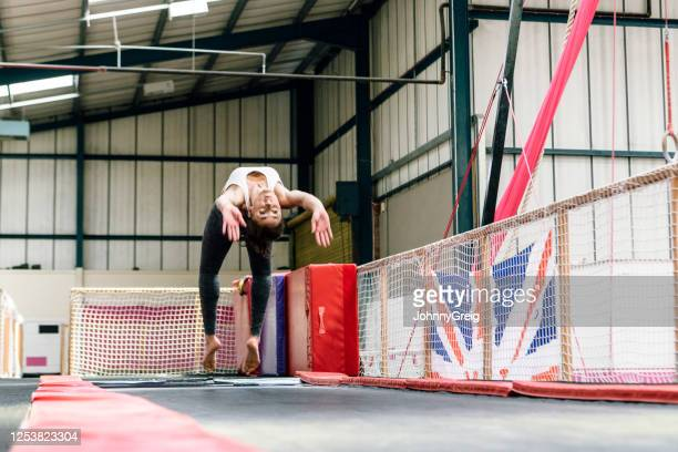 female gymnast practicing back handspring - floor gymnastics stock pictures, royalty-free photos & images