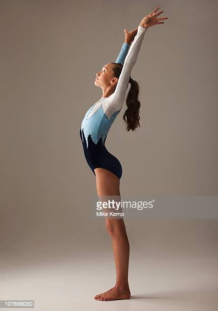 female gymnast (12-13) stretching - little girls leotards stock photos and pictures