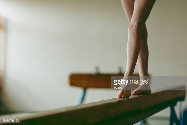 female gymnast walking on balance beam, low section - gymnastics stock pictures, royalty-free photos & images