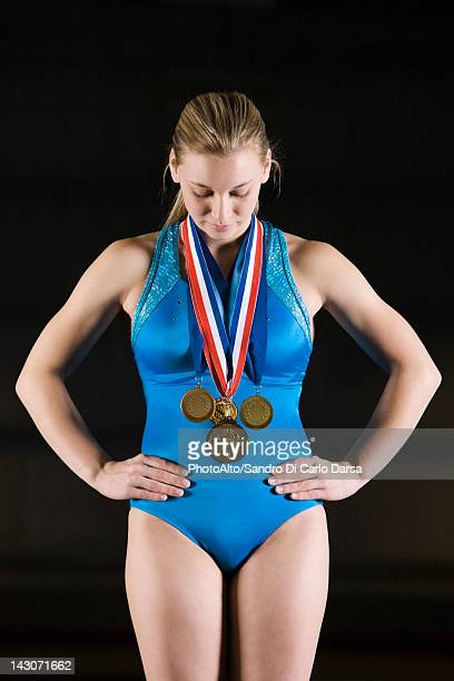 Female gymnast wearing gold medals