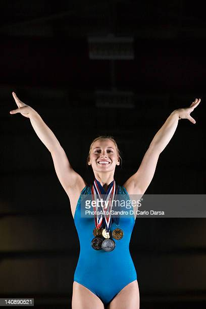 female gymnastic medalist taking bow, portrait - gymnastics poses stock pictures, royalty-free photos & images