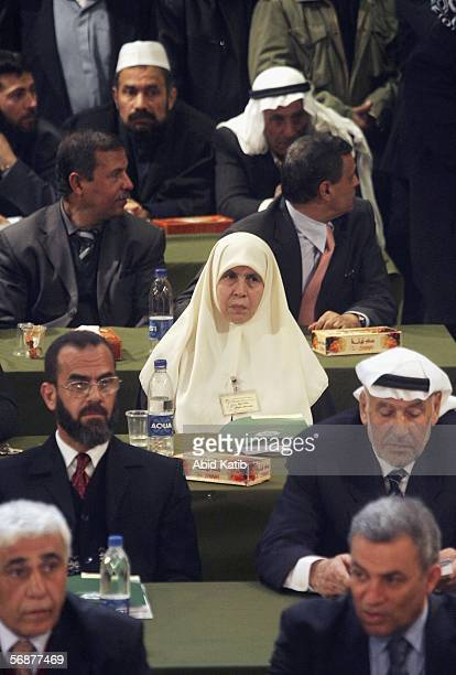 Female Hamas leader Maryam Farahat and other Palestinian Parliament elected members attend the inaugural parliament session on February 2006 in Gaza...