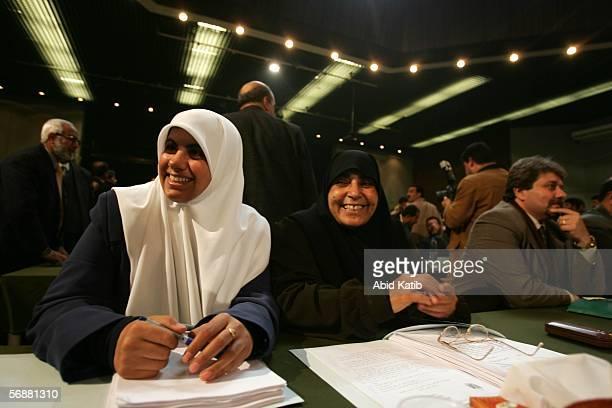Female Hamas leaders Huda Na'em and Jamela AlShanti attend the inaugural parliament session on February 18 2006 in Gaza City Gaza Strip The inaugural...