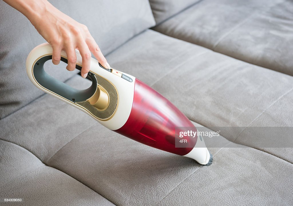 Female Hand cleaning the Sofa Couch : Stock Photo