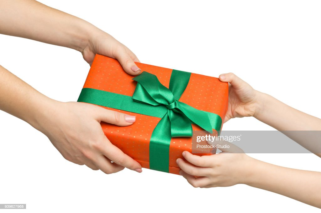 Female hand give present to kid, isolated on white : Stock Photo