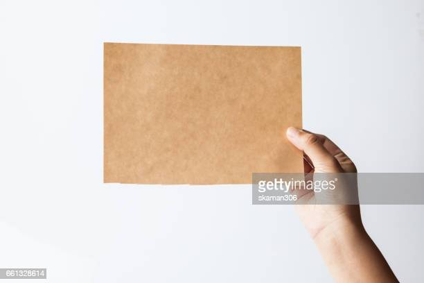 female  hand hold  blank paper isolated white background