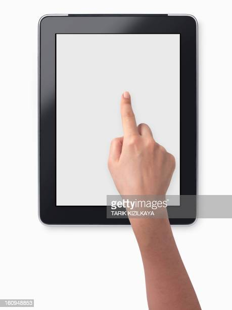 female hand holding a touchscreen, isolated on white background