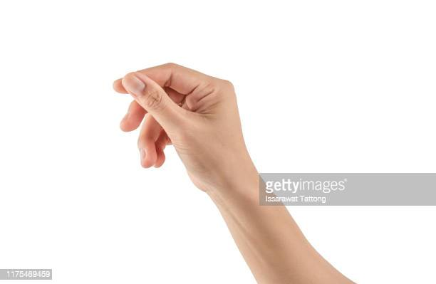 female hand holding a virtual card with your fingers on a white background - cogiendo fotografías e imágenes de stock