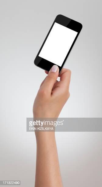 Female hand holding black smart phone