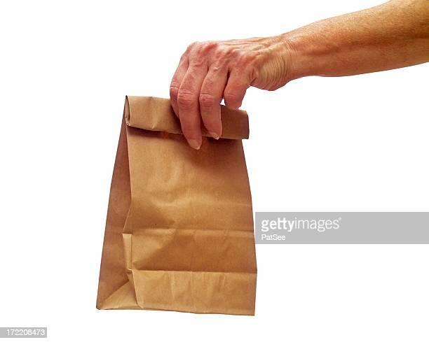 Weibliche hand hält ein Lunchpaket