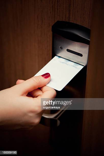 female hand inserting key card into hotel room door lock - door lock stock pictures, royalty-free photos & images