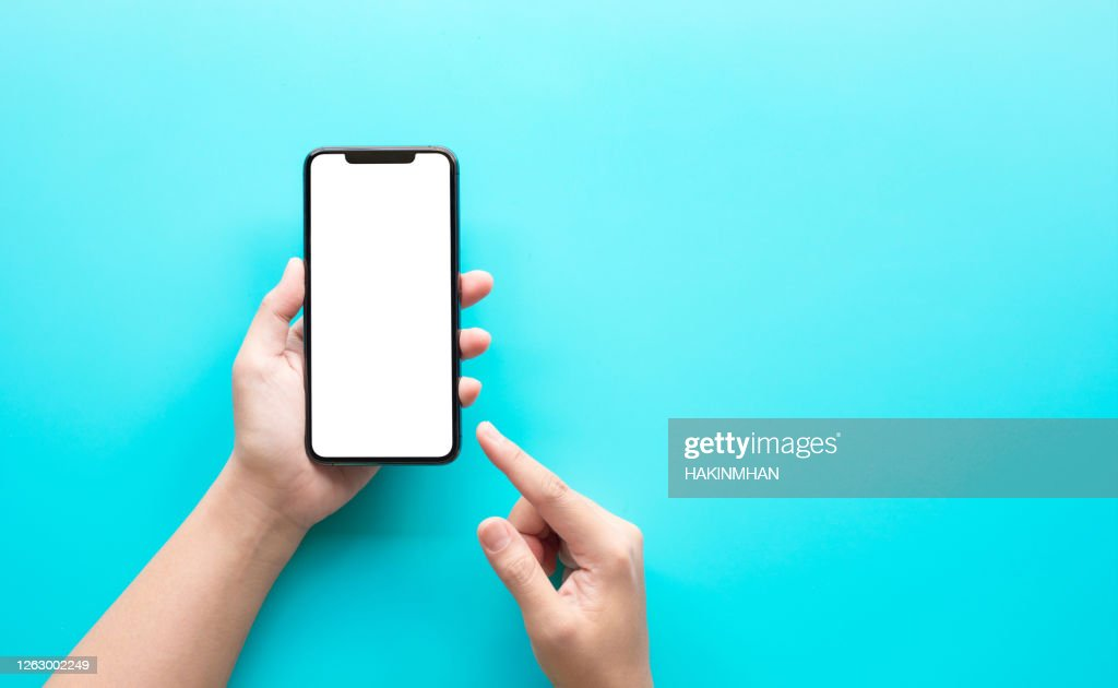 Female hand using smartphone with blank screen on color background : Stock Photo