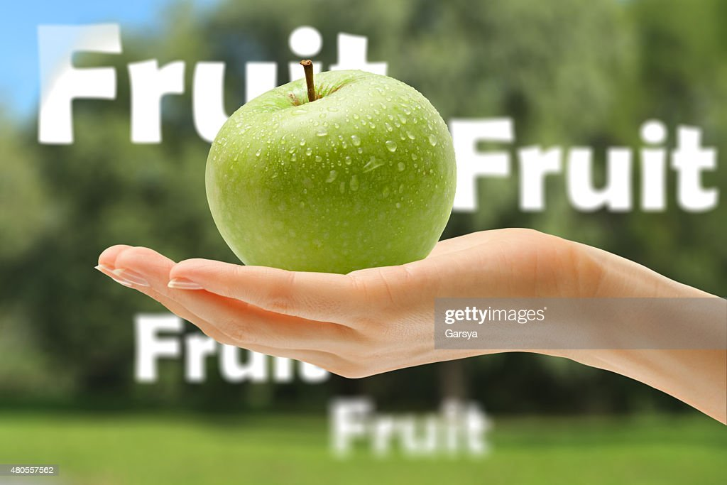 Female hand with green apple : Stock Photo