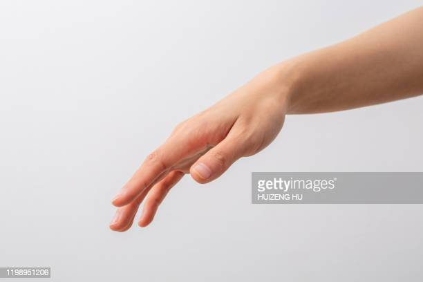 female hand, young woman hand trying to reach for - reaching stock pictures, royalty-free photos & images