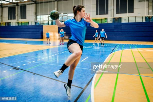 Female handball player throwing ball