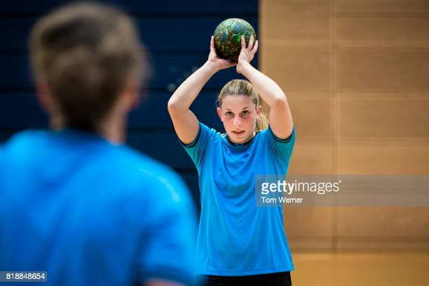 Female handball player with ball