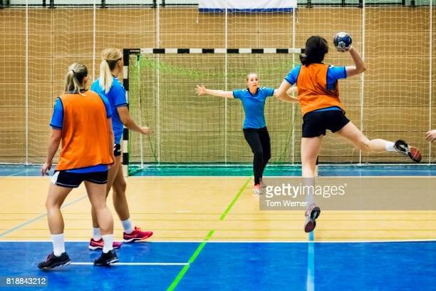 female handball players during training session - handball stock pictures, royalty-free photos & images