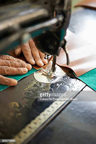 Female hands and sewing machine in textile factory, Thamel, Kathmandu, Nepal