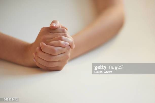female hands clasped, close up. - gesturing stock pictures, royalty-free photos & images