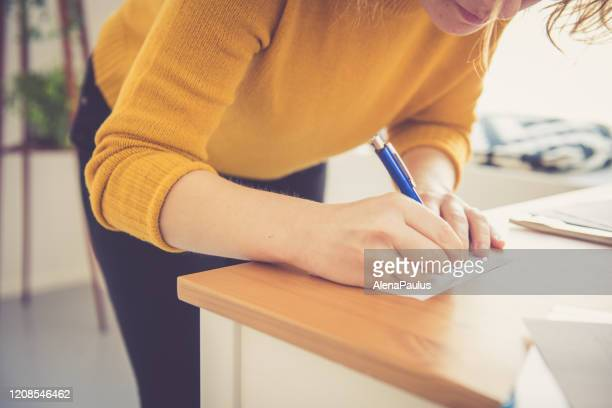 female hands close up writing notes with a pen - handwriting stock pictures, royalty-free photos & images